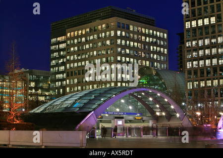 Canary Wharf and Canada Square, entrance to underground station and skyscrapers at dusk, Docklands, London, England, - Stock Photo