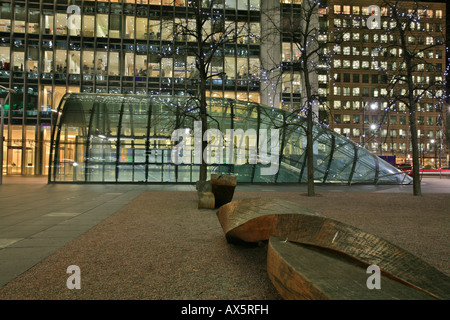 Canary Wharf and Canada Square, bench sculpture, entrance to underground station and skyscrapers, Docklands, London, - Stock Photo