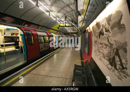 Train arriving at Baker Street underground station, painting of the Hound of Baskerville, London, England, UK, Europe - Stock Photo
