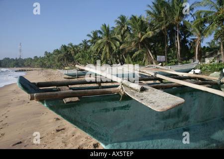 Fishing boat on the beach, Tangalle, Sri Lanka, Asia - Stock Photo