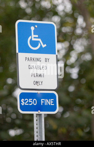 Sign marking a disabled parking space at a parking lot in Florida, USA - Stock Photo