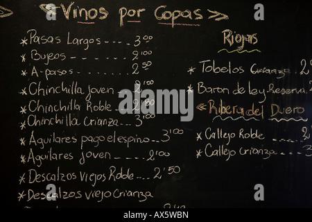 Wine list written on chalkboard at Tragatapas Tapas Bar, Ronda, Andalusia, Spain, Europe - Stock Photo