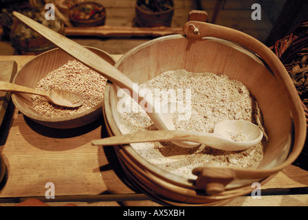 Wooden bowl filled with cereal, exhibit at Bostad Borg Viking Museum, Lofoten, Norway, Europe - Stock Photo