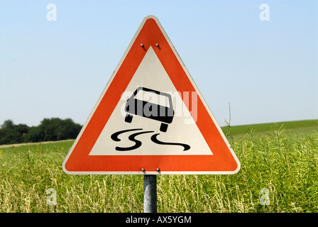 Traffic sign, slippery when wet - Stock Photo