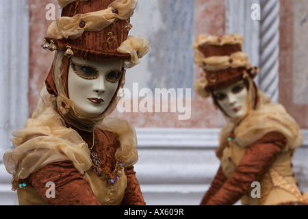 Masks, costumes during Carnival in Venice, Italy, Europe - Stock Photo