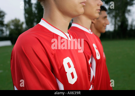 Soccer players forming a wall - Stock Photo