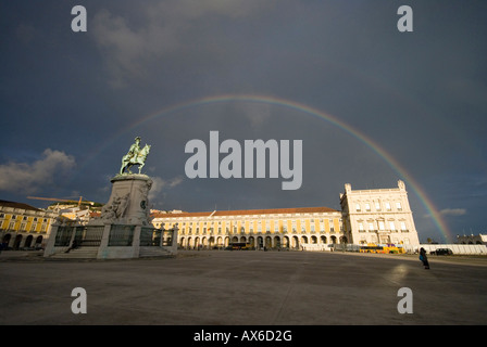 Rainbow over commerce square in Lisbon Portugal - Stock Photo