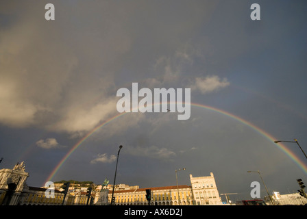 Rainbow over commerce square in Lisbon - Stock Photo