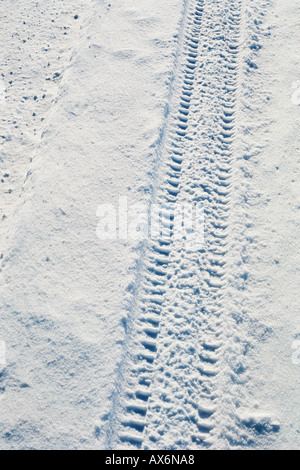 Tyre track in the snow - Stock Photo