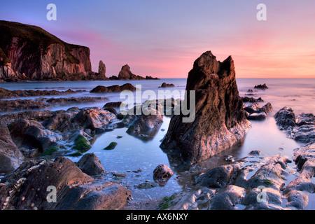 Jagged rocks and cliffs around Bantham in South Devon - Stock Photo