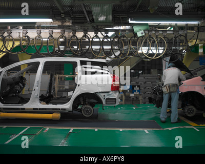 Factory workers producing the hybrid Toyota Prius cars work on the assembly line at the Toyota City - Stock Photo