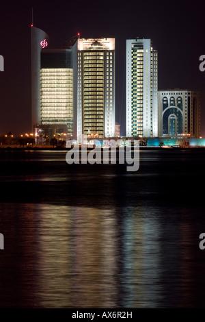 Skyscrapers at waterfront, Doha, Qatar - Stock Photo