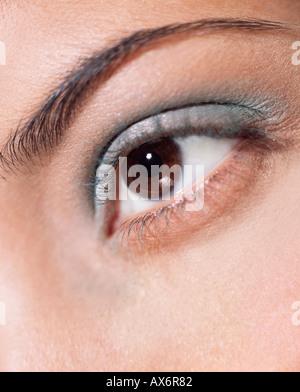Woman's eye with green eyeshadow - Stock Photo