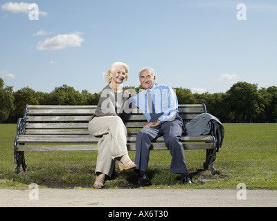 Elderly couple on a park bench - Stock Photo