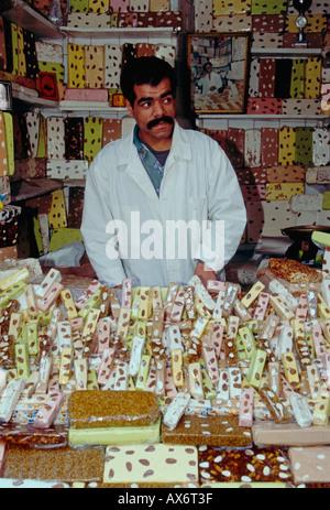 Moroccan man, adult, man, vendor, candy vendor, selling candy, selling candies, selling sweets, sweet shop, medina, - Stock Photo