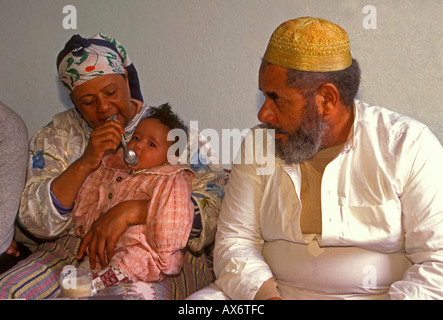 Moroccan family, at home, Fes el-Bali, city of Fez, Morocco - Stock Photo