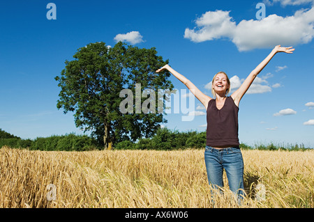 Happy woman in a field - Stock Photo