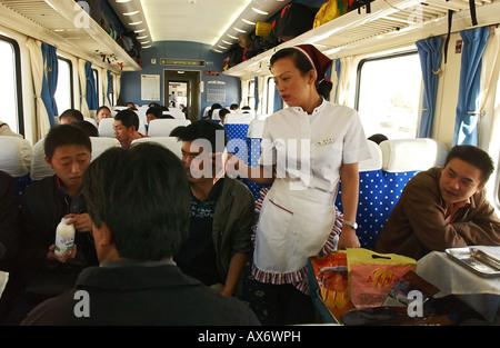Passengers buy food on board the Tibet train, Tibet railway - Stock Photo