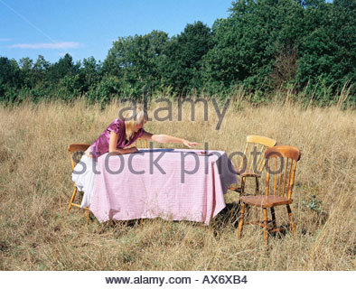 Woman reaching for the last cup cake - Stock Photo