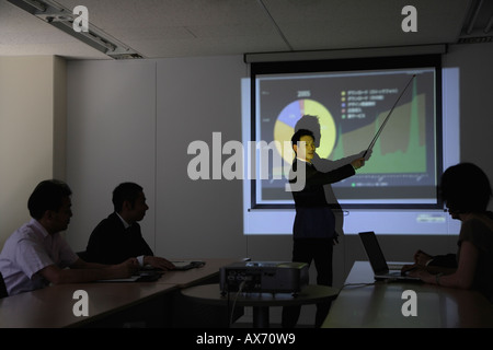 Businessman with a graphical representation at a conference - Stock Photo