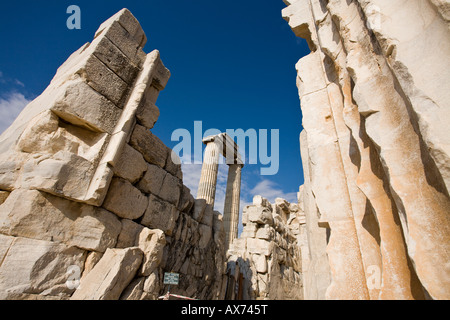 Entrance Door A great portico frames a view of walls and standing columns of the temple in the ancient Greek ruins - Stock Photo