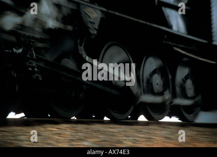 Wheels of a Steam Train in motion - Stock Photo