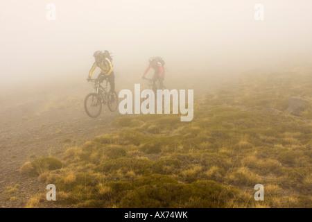 Spain, Sierra Nevada, mountainbiking and fog - Stock Photo