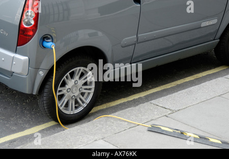 Electric car plugged in for recharging on street, City of Westminster, London SW1, Engand - Stock Photo