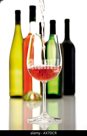 Wine poured into wine glass - Stock Photo