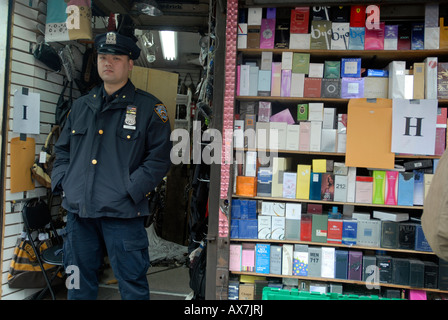Counterfeit goods are seized in Chinatown and merchants selling the goods are shut down - Stock Photo