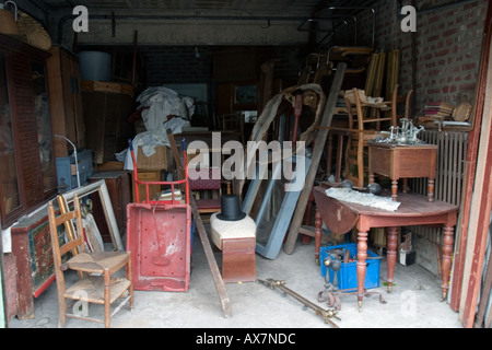 Eclectic mix of junk and bric a brac in garage sale at St Valery sur Somme - Stock Photo