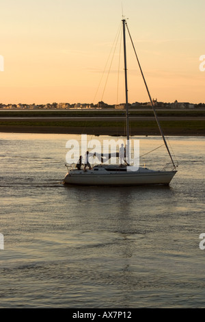 Last yachts coming up the Somme estuary as the sunsets on another days sailing Saint Valery sur Somme - Stock Photo