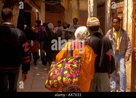Moroccans, Moroccan people, medina, Fes el-Bali, city of Fez, Fez, Morocco, North Africa, Africa - Stock Photo