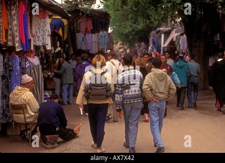 Moroccan people, tourist with guide, guided tour, shopping, city of Fez, Morocco - Stock Photo