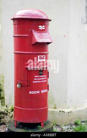 Free standing Red Pillar Post Box an icon of British colonial rule in India Fort kochi Cochin kerala India - Stock Photo