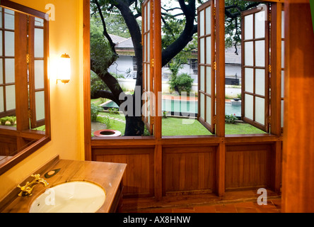 Garden view from Dutch colonial style bathroom attached to guest bedroom. Old Harbour Hotel heritage monument Fort - Stock Photo