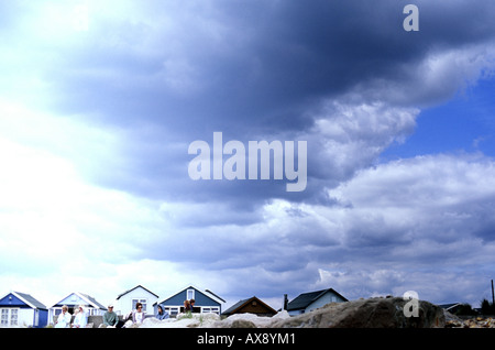 Beach huts along sandy beach at Hengistbury Head Dorset - Stock Photo