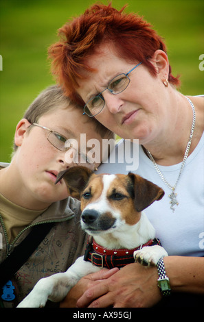 Mother and son holding pet Jack Russell terrier dog - Stock Photo
