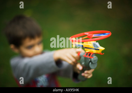 Boy with toy helicopter six years old - Stock Photo