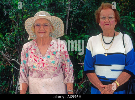 Two elderly ladies photographed out walking West End, Cayman Brac, Cayman Islands - Stock Photo