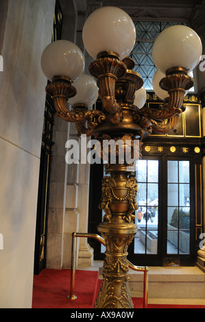 Ornate lamps stand at the entrance of the century-old Plaza Hotel, which recently reopened in Manhattan. - Stock Photo
