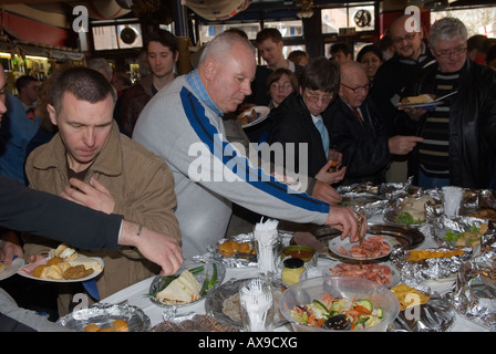 The 'Widows Son'  Inn Bromley by Bow East London Easter Good Friday party Party buffet food. HOMER SYKES - Stock Photo