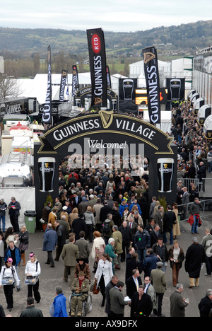 The Guinness village at Prestbury Racecourse during the Cheltenham National Hunt Festival - Stock Photo