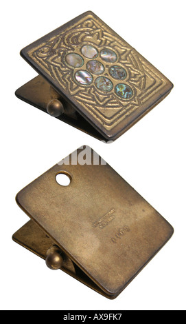Obverse and reverse of Tiffany Studios Abalone pattern paper clip, circa 1905. This image has a clipping path. - Stock Photo