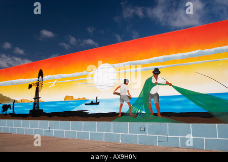 Mural depicting fishing scene painted on wall in village on Lanzarote in the Canary islands. - Stock Photo