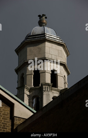 The smaller tower of Saint-George's-in-the-East Church of England church in the London east end Borough of Tower - Stock Photo