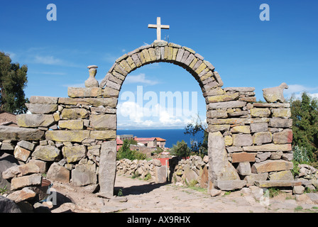 Stone arch with cross on the island of Taquile in Lake Titicaca off the coast of Puno, Peru - Stock Photo