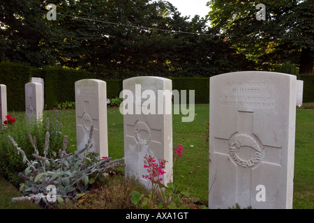 Line of graves of soldiers from Maori Battalion who died in WW1 - Ramparts cemetery Lille Gate Ypres Belgium - Stock Photo
