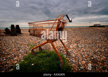 A rusty shopping trolley on a Sussex beach front. Picture by Jim Holden. - Stock Photo