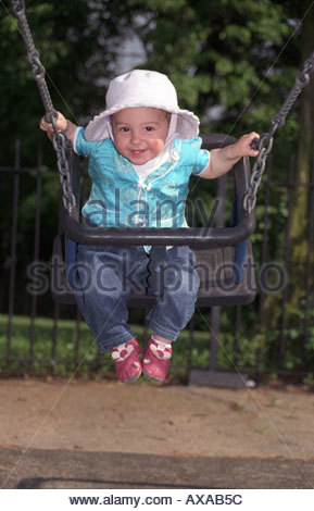 11 Month Old Baby Girl Sitting In Toddler Swing The Park London UK